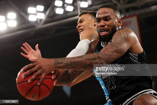 Shawn Long of United competes for the ball with RJ Hampton of the Breakers during the round four NBL match between Melbourne United and the New...
