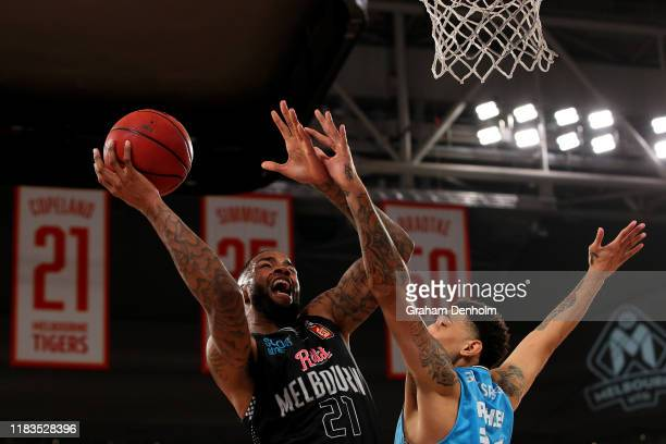 Shawn Long of United drives at the basket during the round four NBL match between Melbourne United and the New Zealand Breakers at Melbourne Arena on...