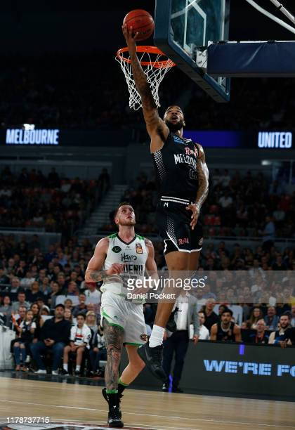 Shawn Long of United drives to the basket against Mitch Creek of the Phoenix during the round one NBL match between Melbourne United and the South...