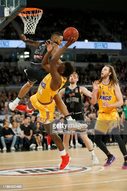 Shawn Long of United fouls Jae'Sean Tate of the Kings during the round five NBL match between Melbourne United and the Sydney Kings at Melbourne...