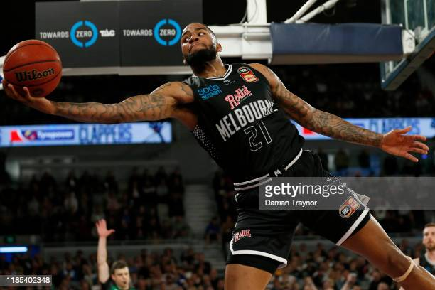 Shawn Long of United keeps the ball in play during the round five NBL match between Melbourne United and the Sydney Kings at Melbourne Arena on...