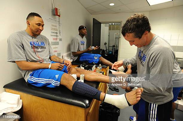 Shawn Marion and Brendan Haywood of the Dallas Mavericks get their ankles taped prior to Game One of the 2011 NBA Finals against the Miami Heat on...