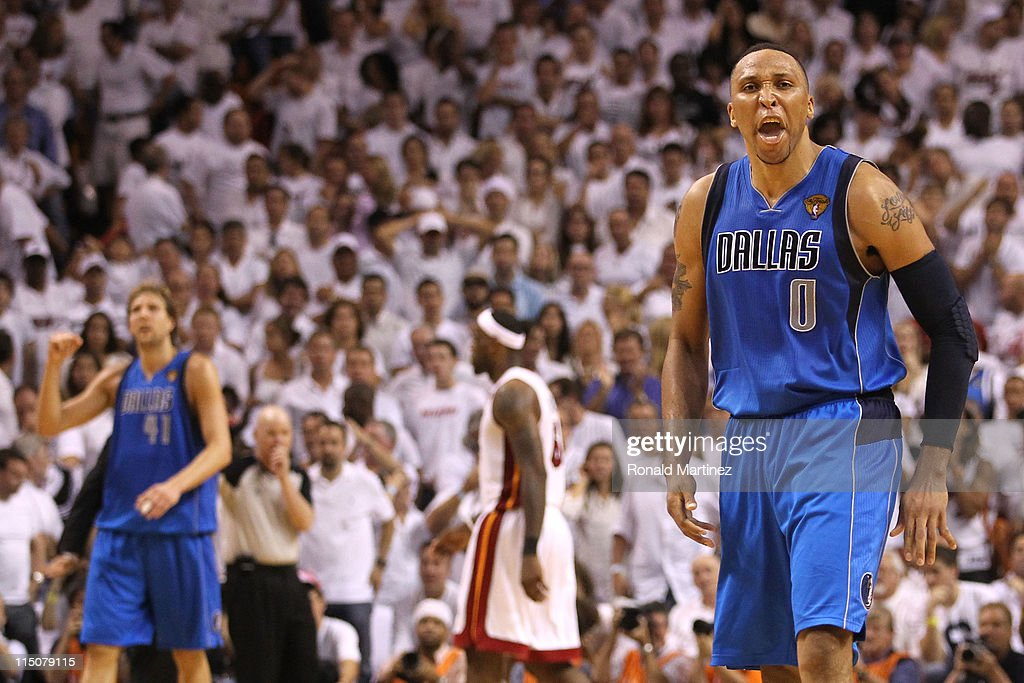 Shawn Marion #0 (R) and Dirk Nowitzki #41 (L) of the Dallas Mavericks celebrate as LeBron James #6 of the Miami Heat walks towards the bench in Game Two of the 2011 NBA Finals at American Airlines Arena on June 2, 2011 in Miami, Florida. THe Mavericks won 95-92.