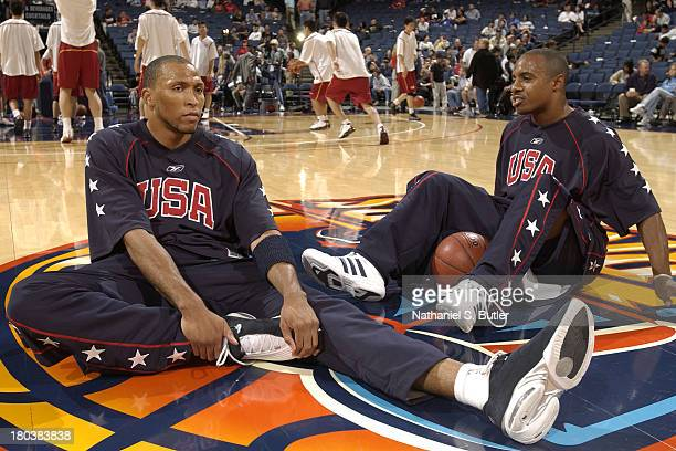 Shawn Marion and Jay Williams of the USA Basketball Men's Championship Team stretches before the game against the China Men's World Championship Team...