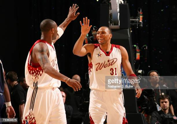 Shawn Marion and Kobe Bryant of the Western Conference celebrate a play against the Eastern Conference during the 2007 NBA AllStar Game on February...