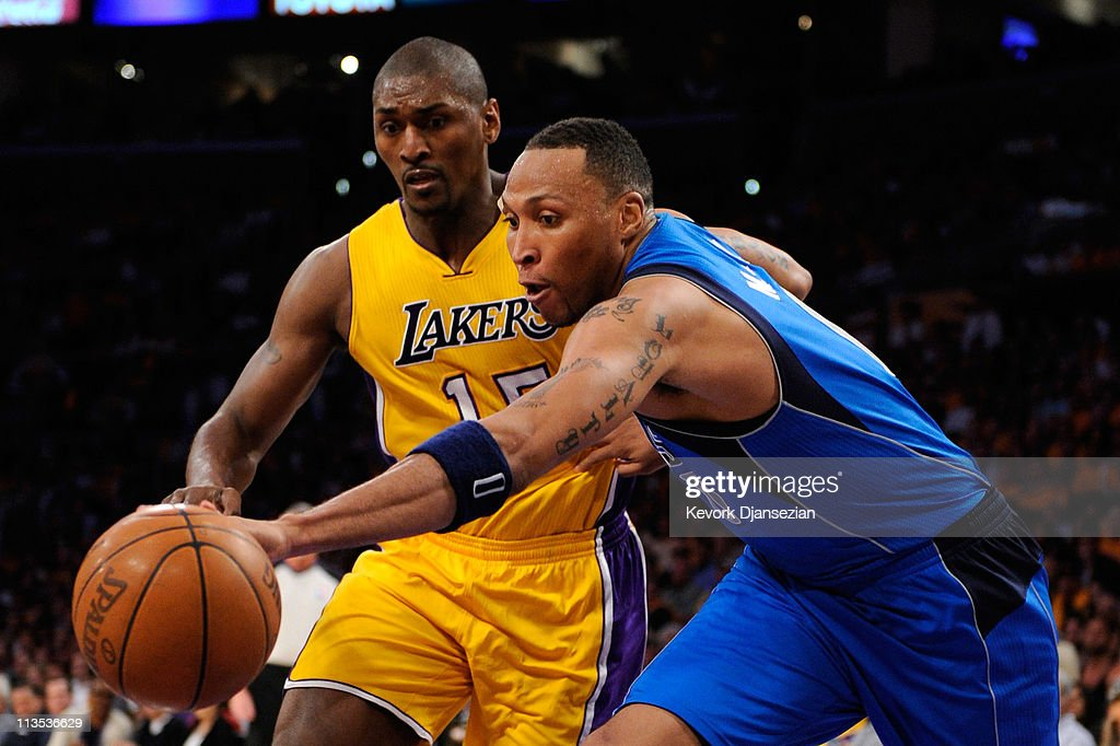 Shawn Marion #0 of the Dallas Mavericks and Ron Artest #15 of the Los Angeles Lakers go after a loose ball in the second half in Game One of the Western Conference Semifinals in the 2011 NBA Playoffs at Staples Center on May 2, 2011 in Los Angeles, California.