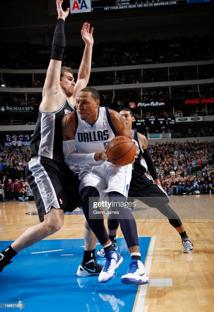 Shawn Marion #0 of the Dallas Mavericks posts up against Tiago Splitter #22 of the San Antonio Spurs on December 30, 2012 at the American Airlines Center in Dallas, Texas.