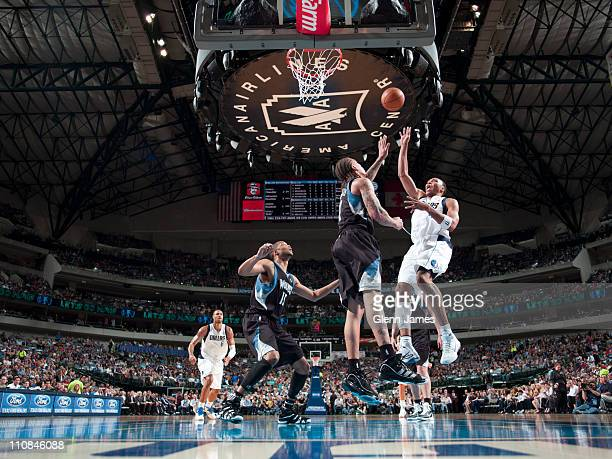 Shawn Marion of the Dallas Mavericks shoots against Michael Beasley of the Minnesota Timberwolves on March 24 2011 at the American Airlines Center in...