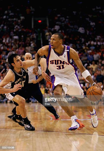 Shawn Marion of the Phoenix Suns drives the ball past Manu Ginobili of the San Antonio Spurs in Game two of the Western Conference Finals during the...