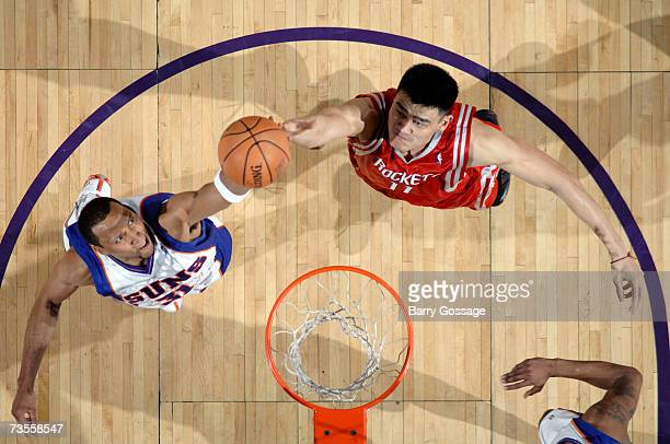 Shawn Marion of the Phoenix Suns fights for a rebound with Yao Ming of the Houston Rockets on March 12 2007 at US Airways Center in Phoenix Arizona...