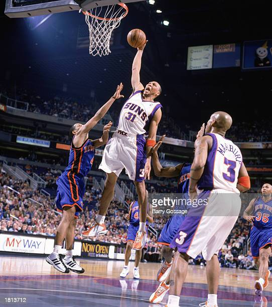 Shawn Marion of the Phoenix Suns goes for a dunk over Howard Eisley of the New York Knicks at American West Arena on February 14 2003 in Phoenix...