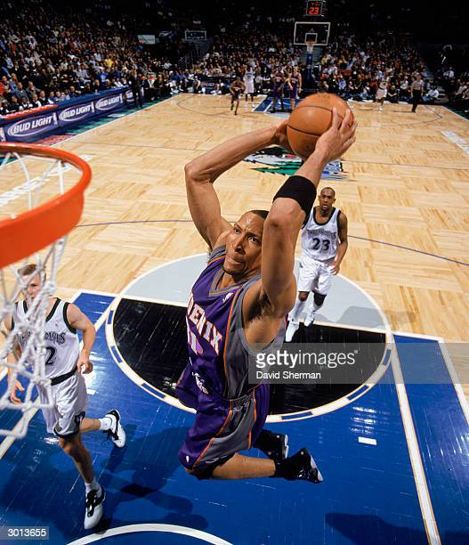 Shawn Marion of the Phoenix Suns goes to the hoop against the Minnesota Timberwolves during the NBA game at Target Center on February 17, 2004 in...