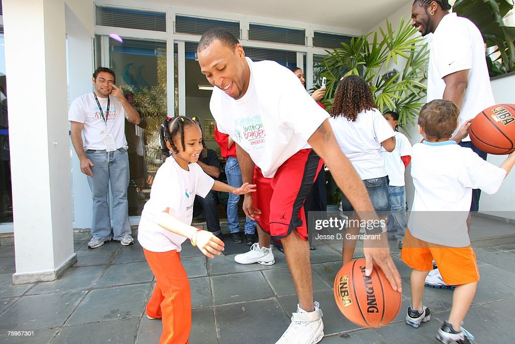 Shawn Marion of the Phoenix Suns plays with a child during Basketball Without Borders on August 3, 2007 in Sao Paulo, Brazil.