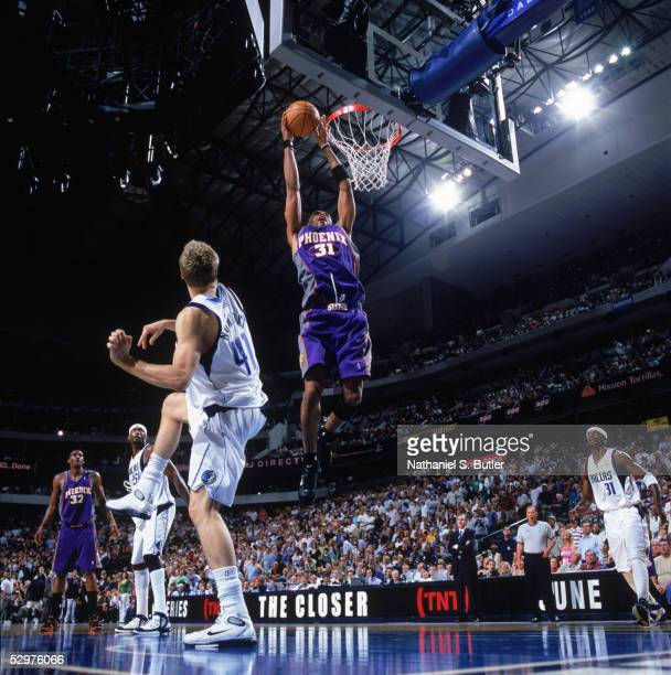 Shawn Marion of the Phoenix Suns takes the ball to the basket past Dirk Nowitzki of the Dallas Mavericks in Game four of Western Conference...