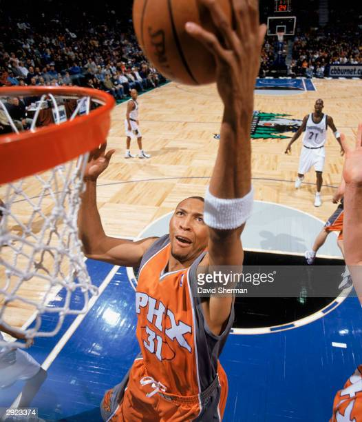 Shawn Marion of the Phoenix Suns takes the ball up against the Minnesota Timberwolves during the NBA game at Target Center on January 25, 2004 in...