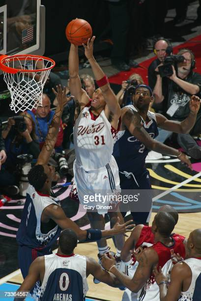 Shawn Marion of the Western Conference dunks the ball against Chris Bosh and LeBron James of the Eastern Conference during the 2007 NBA All-Star Game...