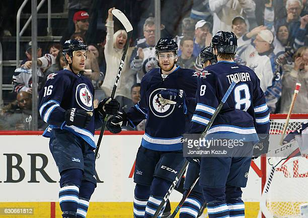 Shawn Matthias Adam Lowry Joel Armia and Jacob Trouba of the Winnipeg Jets celebrate a first period goal against the Columbus Blue Jackets at the MTS...