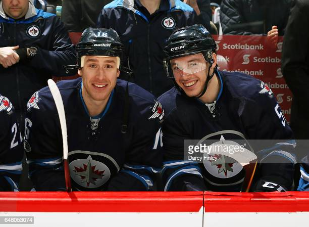 Shawn Matthias and Marko Dano of the Winnipeg Jets are all smiles as they await puck drop against the Colorado Avalanche at the MTS Centre on March 4...