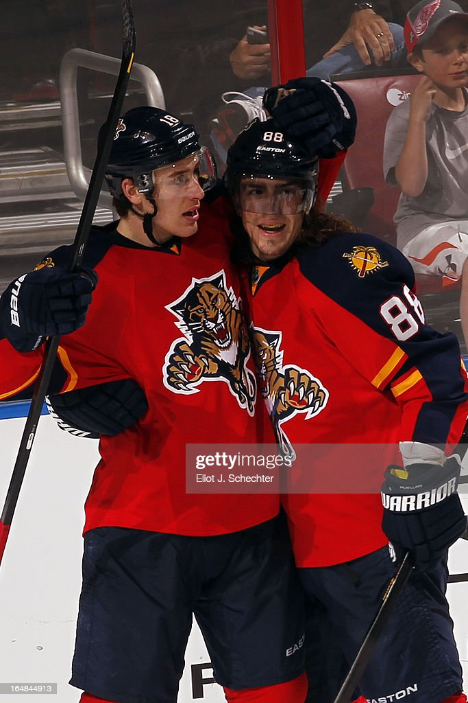 Shawn Matthias #18 of the Florida Panthers celebrates his second goal of the night with teammate Peter Mueller #88 against the Buffalo Sabres at the BB&T Center on March 28, 2013 in Sunrise, Florida.