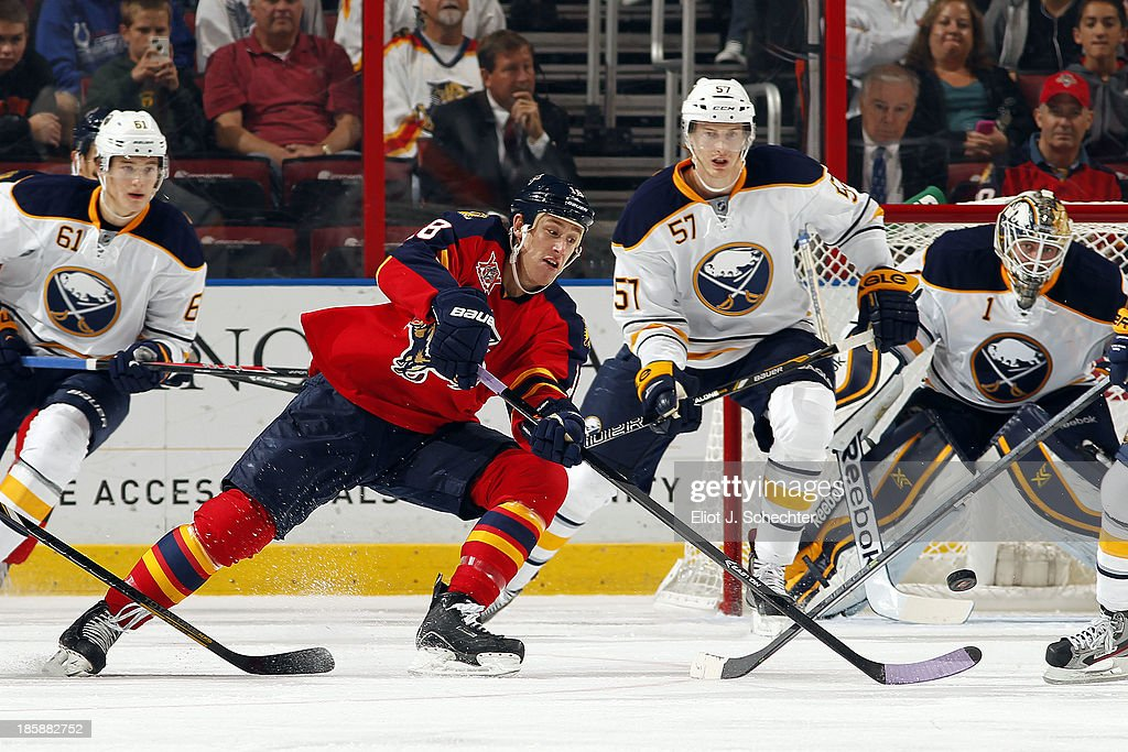 Shawn Matthias #18 of the Florida Panthers passes the puck against the Buffalo Sabres at the BB&T Center on October 25, 2013 in Sunrise, Florida.