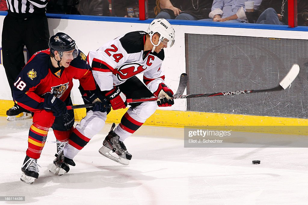 Shawn Matthias #18 of the Florida Panthers tangles with Bryce Salvador #24 of the New Jersey Devils at the BB&T Center on March 30, 2013 in Sunrise, Florida.