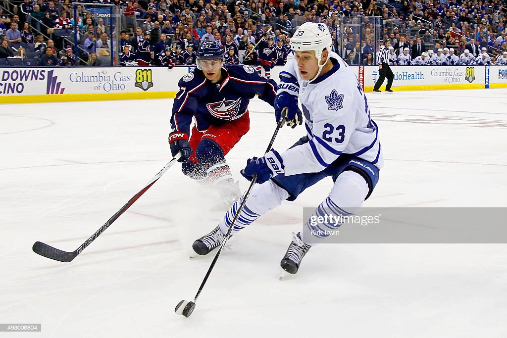 Shawn Matthias #23 of the Toronto Maple Leafs skates the puck away from Ryan Murray #27 of the Columbus Blue Jackets during the third period on October 16, 2015 at Nationwide Arena in Columbus, Ohio. Toronto defeated Columbus 6-3.