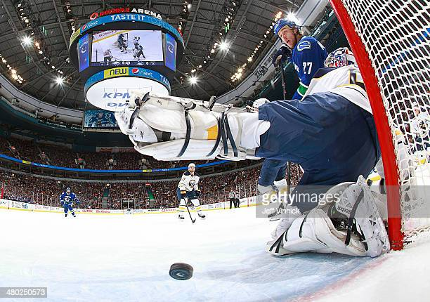 Shawn Matthias of the Vancouver Canucks watches a shot by Brad Richardson of the Canucks beat Nathan Lieuwen of the Buffalo Sabres for a goal during...