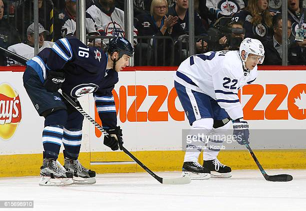 Shawn Matthias of the Winnipeg Jets and Nikita Zaitsev of the Toronto Maple Leafs get set for a first period faceoff at the MTS Centre on October 19...