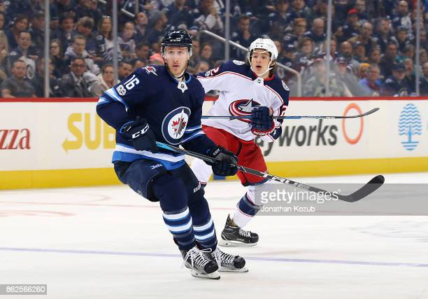 Shawn Matthias of the Winnipeg Jets and Sonny Milano of the Columbus Blue Jackets keep an eye on the play during first period action at the Bell MTS...