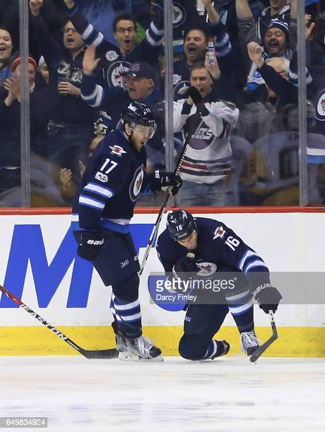 Shawn Matthias of the Winnipeg Jets celebrates his first period goal against the Pittsburgh Penguins with teammate Adam Lowry at the MTS Centre on...