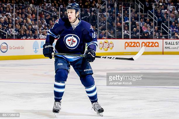 Shawn Matthias of the Winnipeg Jets keeps an eye on the play during first period action against the New York Islanders at the MTS Centre on December...