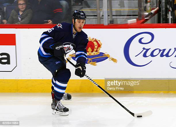 Shawn Matthias of the Winnipeg Jets plays the puck along the boards during second period action against the Buffalo Sabres at the MTS Centre on...