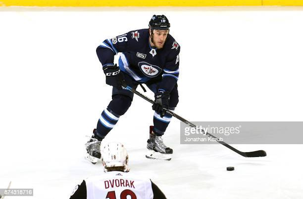 Shawn Matthias of the Winnipeg Jets plays the puck during third period action against the Arizona Coyotes at the Bell MTS Place on November 14 2017...
