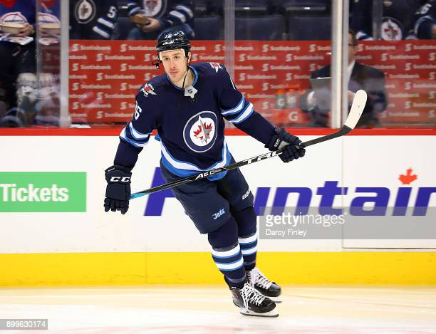 Shawn Matthias of the Winnipeg Jets takes part in the pregame warm up prior to NHL action against the New York Islanders at the Bell MTS Place on...