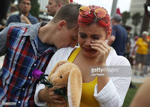 Shawn McCluskey comforts Freedanchy Ruiz as she is overcome with emotion thinking about her cousin that was killed as they stand together during a...