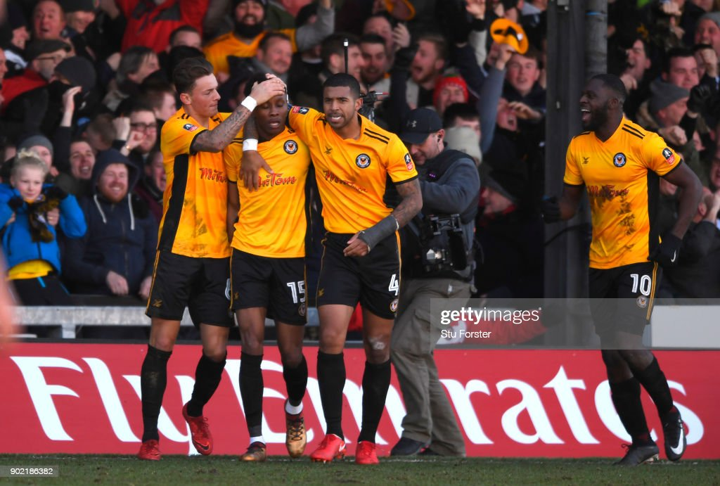 Shawn McCoulsky of Newport County celebrates scoring his side's second goal with team mates during The Emirates FA Cup Third Round match between Newport County and Leeds United at Rodney Parade on January 7, 2018 in Newport, Wales.