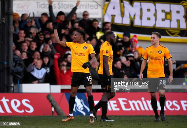 Shawn McCoulsky of Newport County celebrates scoring his side's second goal with team mates during The Emirates FA Cup Third Round match between...