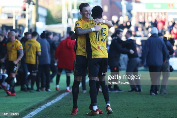 Shawn McCoulsky of Newport County celebrates with Ben White after the final whistle of the Fly Emirates FA Cup Third Round match between Newport...