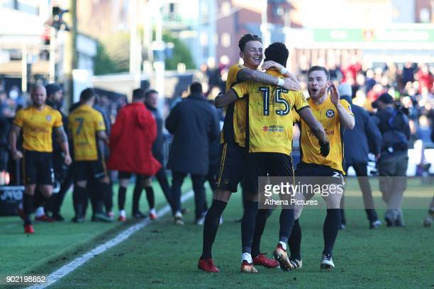 Shawn McCoulsky of Newport County celebrates with Ben White and Mark O'Brien after the final whistle of the Fly Emirates FA Cup Third Round match...