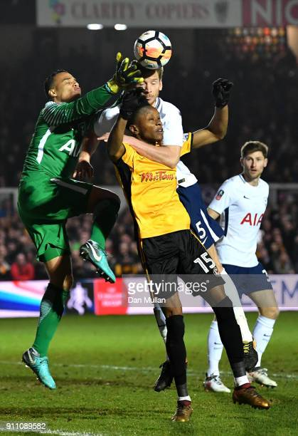 Shawn McCoulsky of Newport County competes for a header with Michel Vorm and Jan Vertonghen of Tottenham Hotspur during The Emirates FA Cup Fourth...