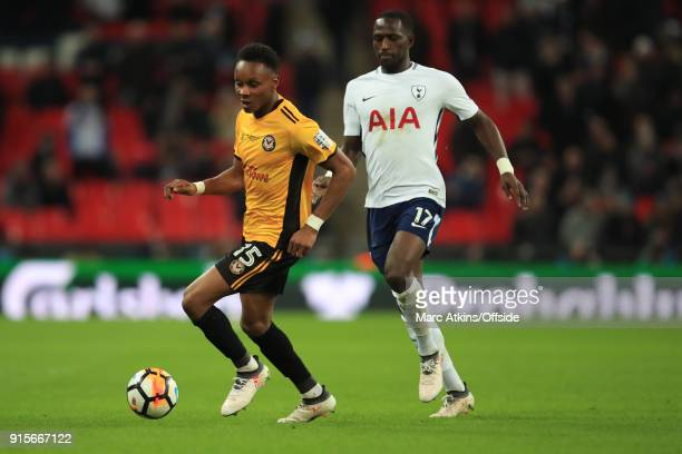 Shawn McCoulsky of Newport County in action with Victor Wanyama of Tottenham Hotspur during the FA Cup Fourth Round replay between Tottenham Hotspur...