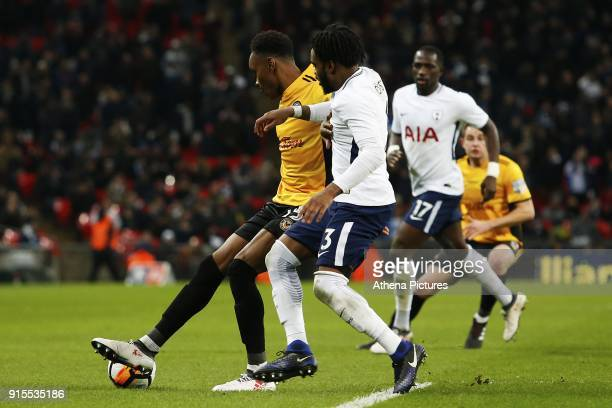 Shawn McCoulsky of Newport County is challenged by Danny Rose of Tottenham Hotspur during the Fly Emirates FA Cup Fourth Round Replay match between...