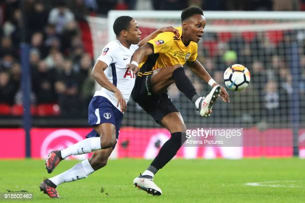 Shawn McCoulsky of Newport County is challenged by Kyle WalkerPeters of Tottenham Hotspur during the Fly Emirates FA Cup Fourth Round Replay match...