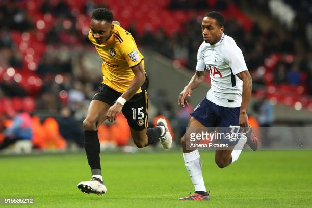 Shawn McCoulsky of Newport County is chased by Kyle WalkerPeters of Tottenham Hotspur during the Fly Emirates FA Cup Fourth Round Replay match...