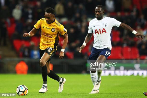 Shawn McCoulsky of Newport County is marked by Moussa Sissoko of Tottenham Hotspur during the Fly Emirates FA Cup Fourth Round Replay match between...