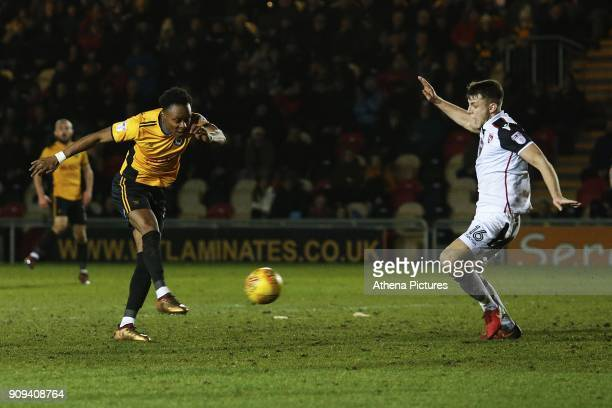 Shawn McCoulsky of Newport County is marked by Sam Lavelle of Morecambe during the Sky Bet League Two match between Newport County and Morcambe at...