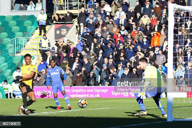 Shawn McCoulsky of Newport County watches as the ball from Frank Nouble cross deflects off Conor Shaughnessy of Leeds United for an own goal during...