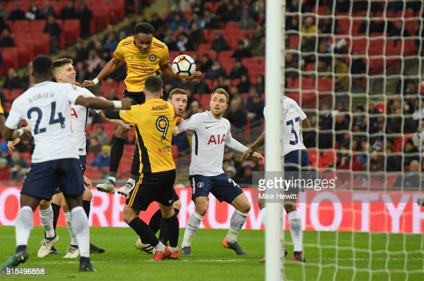 Shawn McCoulsky of Newport County wins a header during The Emirates FA Cup Fourth Round Replay match between Tottenham Hotspur and Newport County at...