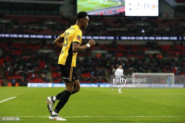 Shawn McCoulsky of Newport County with the scoreboard showing 20 to Tottenham during the Fly Emirates FA Cup Fourth Round Replay match between...