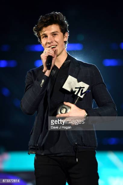 Shawn Mendes accepts one of his three awards on stage during the MTV EMAs 2017 held at The SSE Arena Wembley on November 12 2017 in London England